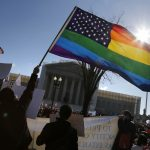 Anti-Proposition 8 protesters wave a rainbow flag in front of the U.S. Supreme Court in Washington, March 26, 2013. Two members of the U.S. Supreme Court, both viewed as potential swing votes on the right of gay couples to marry, raised doubts about California's gay marriage ban on Tuesday as they questioned a lawyer defending the ban. REUTERS/Jonathan Ernst
