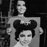 "Annette Funicello (circa 1975) holding a photograph of herself as a child star on ""The Mickey Mouse Club"""