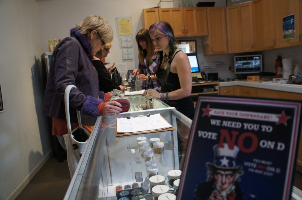 Along with their cannabis, customers at L.A.'s marijuana dispensaries are getting a dose of campaign information and election advice. The dispute Proposition D and Proposition F has divided L.A.'s cannabis community.  (Photo by Saul Gonzalez)