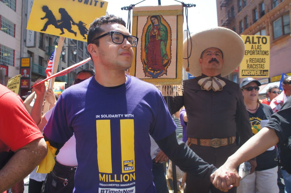 Many marchers wore shirts and carried signs with the number 11 million printed on them. That refers to the estimated 11 million undocumented people living in the United States.