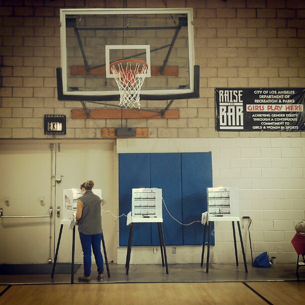 Los Angeles voter Amanda Sutton casts a ballot in the Silver Lake neighborhood of Los Angeles. Photo by Avishay Artsy