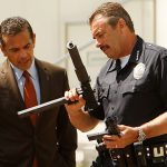 Los Angeles police Chief Charlie Beck and Mayor Antonio Villaraigosa look over weapons collected at an LA gun buyback event in May 2012. Credit: Al Seib / Los Angeles Times