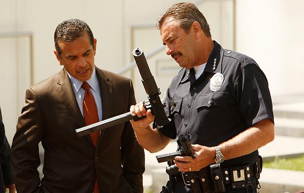 Los Angeles police Chief Charlie Beck and Mayor Antonio Villaraigosa look over weapons collected at an LA gun buyback event in May 2012. Credit: Al Seib / Los Angeles Times