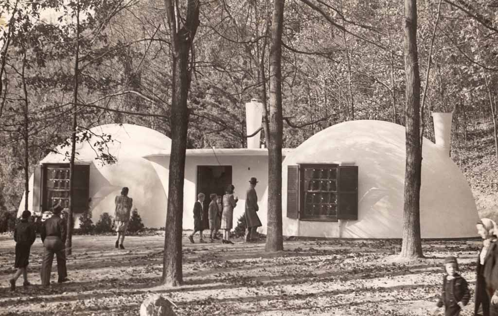"Visitors at the Falls Church, Virginia bubble houses also known as ""Igloo Village,"" 1942. Photo by Wallace Neff. Image from from ""No Nails, No Lumber: The Bubble Houses of Wallace Neff"" by Jeffrey Head. Princeton Architectural Press."
