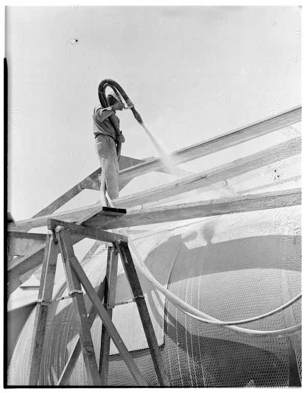 A worker applies the first of two layers of gunite to the inflated Airform balloon. (Huntington Library) Image from