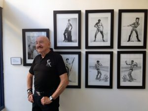 Photographer John Palatinus with some of his images
