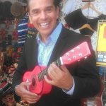 LA Mayor Antonio Villaraigosa tests a toy guitar at a Mexican crafts stand on Olvera Street on Friday, June 28. Photo by Avishay Artsy.
