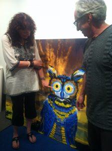 L: Deborah Ross center: An owl R: Robbie Conal