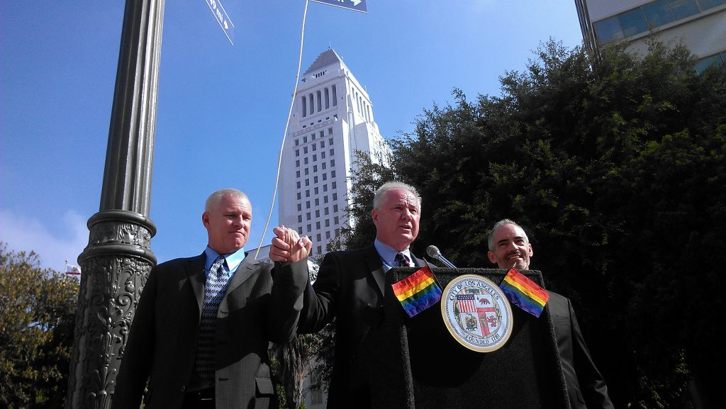 "LA City Councilmen Mike Bonin, Tom LaBonge and Mitch O'Farrell, under the ""Sister Cities"" sign at First and Main Streets. Photo by Avishay Artsy."
