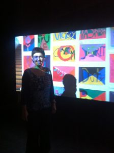 Artist Bia Gayotto in front of her two-screen installation