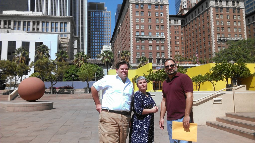 From left: Richard Schave, Kim Cooper and Steve Chiotakis in Pershing Square. Photo by Avishay Artsy.