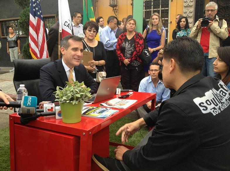 LA Mayor Eric Garcetti speaking with Armando Gonzalez of Soul Skating L.A. at the Boyle Heights pop-up office. Photo via the mayor's Facebook page.