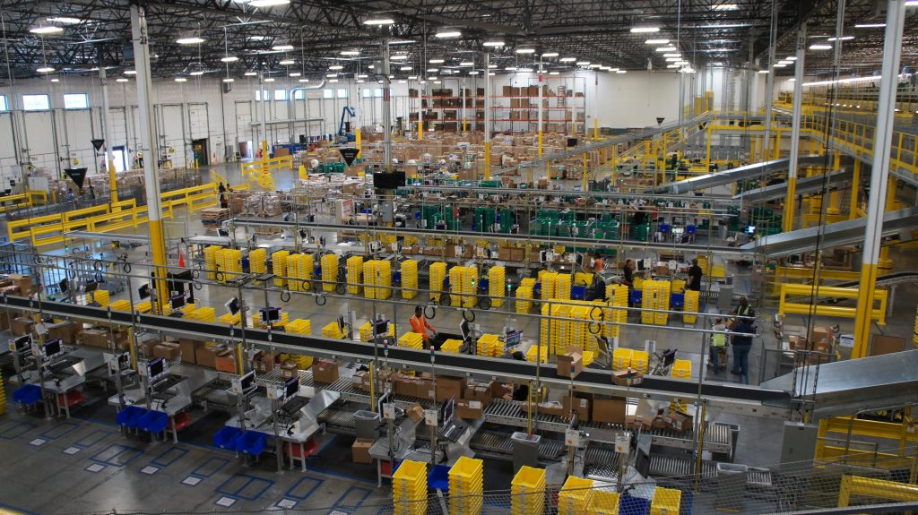 The Amazon Fulfillment Center in San Bernardino is enormous, 1-million-square-feet in size. To put that another way, that's about the same size as 50 football fields put side by side. When you walk through the distribution center, you're surrounded by assembly lines of workers packaging products quickly and efficiently to send off to customers. It's the closest you can to Santa's workshop without going to the North Pole. (Photo by Saul Gonzalez)