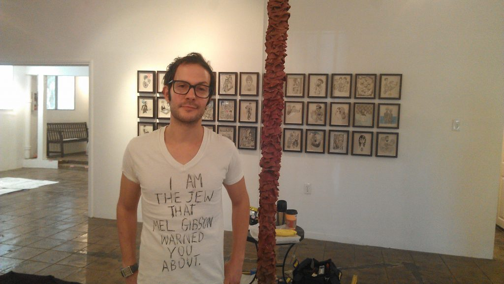 Will Deutsch at the Gabba Gallery, next to a six foot tall pastrami sandwich. Photo by Avishay Artsy.