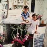 Lizbeth and her brother visit their grandmother's grave in Oaxaca.