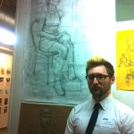 Nick Edinger says he always knew he wanted to be an artist.  A former combat illustrator for the Marines, he stands in front of his work at Otis, where he now studies.