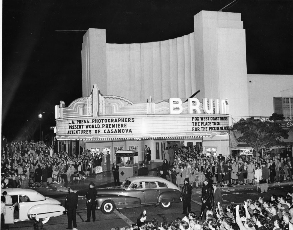 "11.BRUIN THEATER PREMIERE, 1948:  Glittering Hollywood film premieres have attracted throngs of movie fans to Westwood Village since the 1930s, eager to catch a glimpse of their favorite stars.  Here the ""Adventures of Casanova"" gets the Hollywood red carpet treatment in 1948 in a simultaneous double premiere at both the Bruin and Fox Westwood Village Theaters.  The Bruin Theater opened across the street opposite the Fox Theater in 1937, as the second movie theater in the Village.  This City Historic-Cultural Monument was designed by renowned theater architect S. Charles Lee in Streamline Moderne style, with UCLA inspired blue-and-gold neon flashing along the sweeping curve of its Art Deco style theater marquee.  Photo and caption courtesy of Steven Sann."
