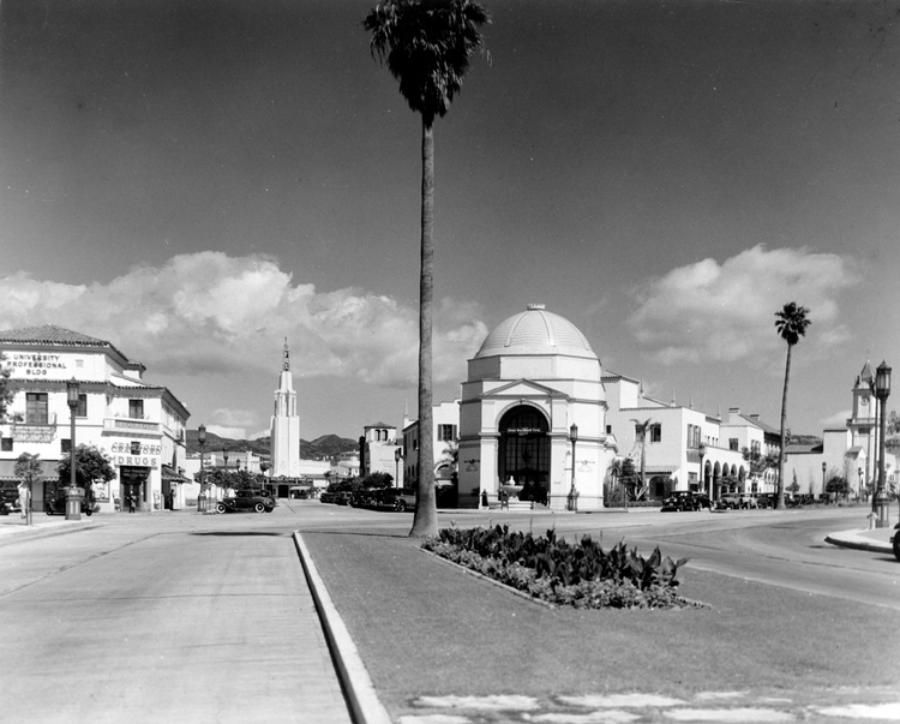 "1934: Reflecting the ""Mediterranean"" architecture mandated by the Janss Corporation are these four historic structures looking north on Westwood Boulevard at Kinross Avenue, left to right, the University Professional Building, the soaring tower of the Fox Westwood Village Theater, the imposing Janss Investment Corporation headquarters – popularly known as ""the Dome building,"" and Holmby Hall with its stately clock tower, as seen in 1934.  All four of these historic buildings still exist.  Photo and caption courtesy of Steven Sann."