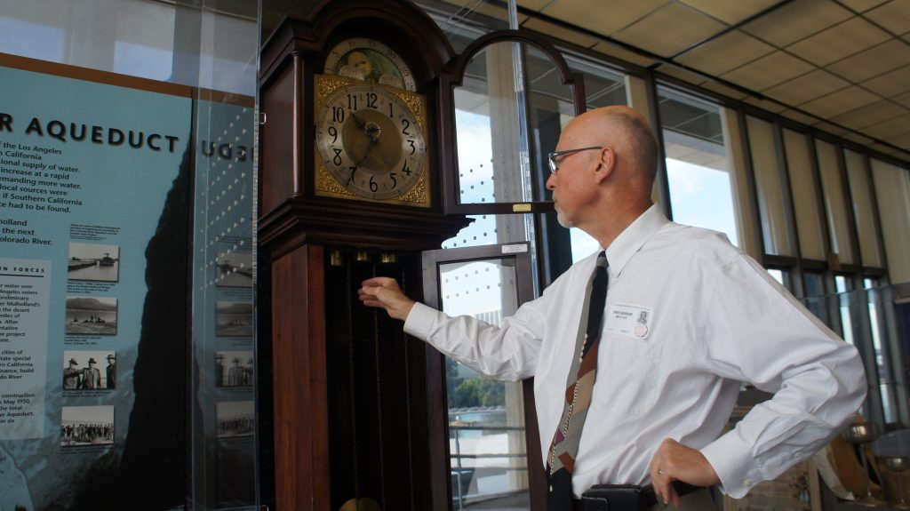 DWP's Fred Barker winds a clock, once belonging to William Mulholland. (Photo: Saul Gonzalez)