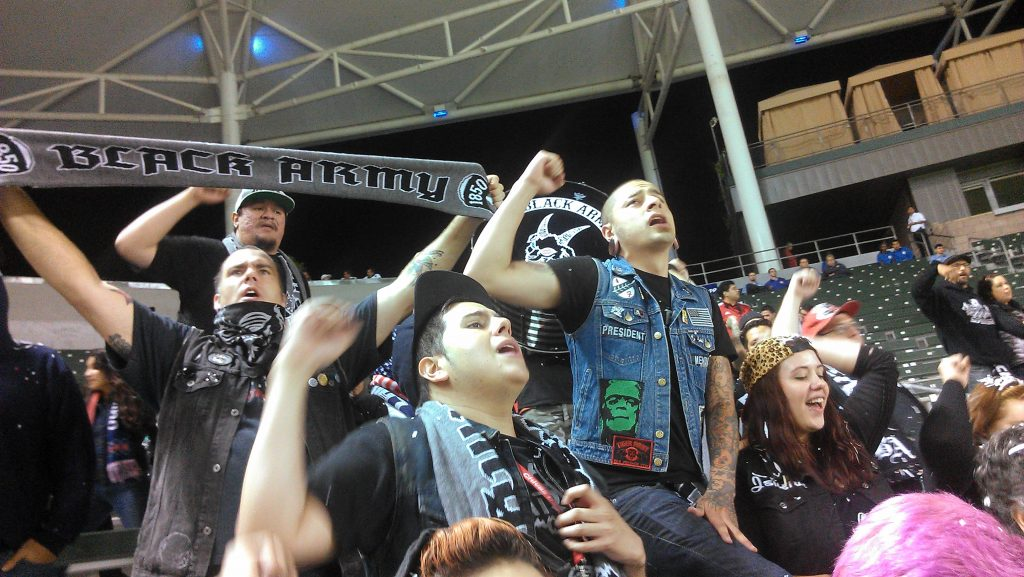 Members of the Black Army 1850, a Chivas USA supporter group, cheer on their team in the final minute of the game. (Photo: Avishay Artsy)