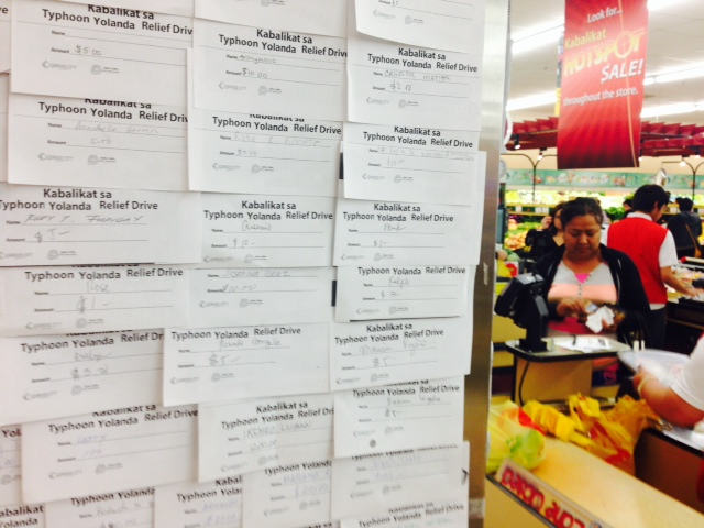 Typhoon relief pledges at at Eagle Rock Plaza Mall outside of Filipino supermarket. (Photo: Saul Gonzalez)