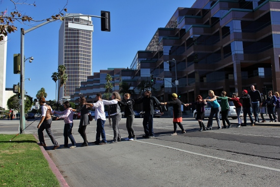 """Carmen Papalia's """"Blind Field Shuttle"""" is part of a group show at the Craft and Folk Art Museum (CAFAM) called """"Artifacts of a Life Lived by the Living (to Live)."""" He began the tour in front of the museum, then led the group across Wilshire, into the park surrounding the La Brea Tar Pits."""
