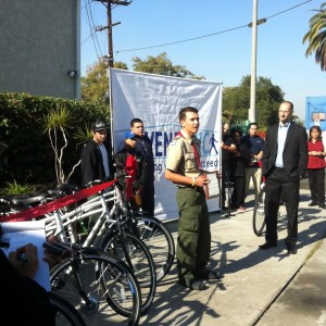 17 year old Diego Binatena, Boy Scout Troop 927, presents electric bikes to less fortunate youth in Boyle Heights