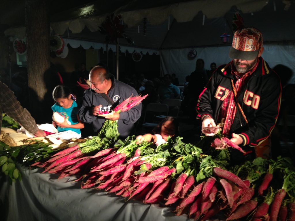 300 pounds of radishes, available for carving