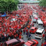 "2010 photograph of a ""Red Shirt"" protest at Ratchaprasong intersection, an area in downtown Bangkok which was occupied by the red shirts between April 3, 2010, and May 19, 2010."