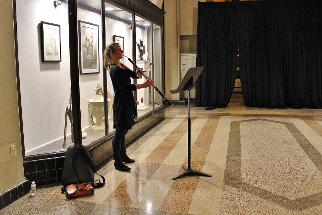 "A performer from the wild Up orchestra plays a ""Solo for English Horn"" written by Lisa Bielawa. Bielawa is currently at work on a residency at the Grand Central Art Center, which sits across the street from the Santora."