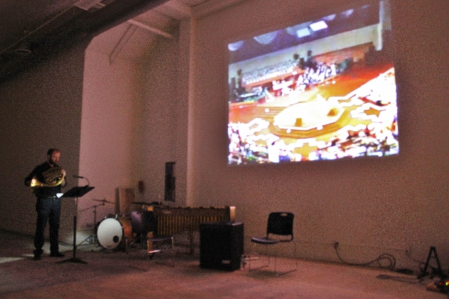 An installation by Chris Kallmyer occupied one of the spaces at the Santora. An art video featuring a mumbling track of television preachers also included a live performance on French horn.