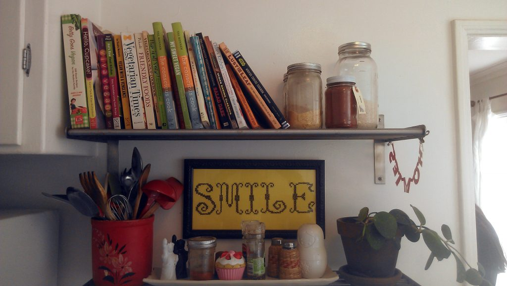 A shelf of vegan cookbooks above the oven at Polito's family's apartment in Atwater Village.