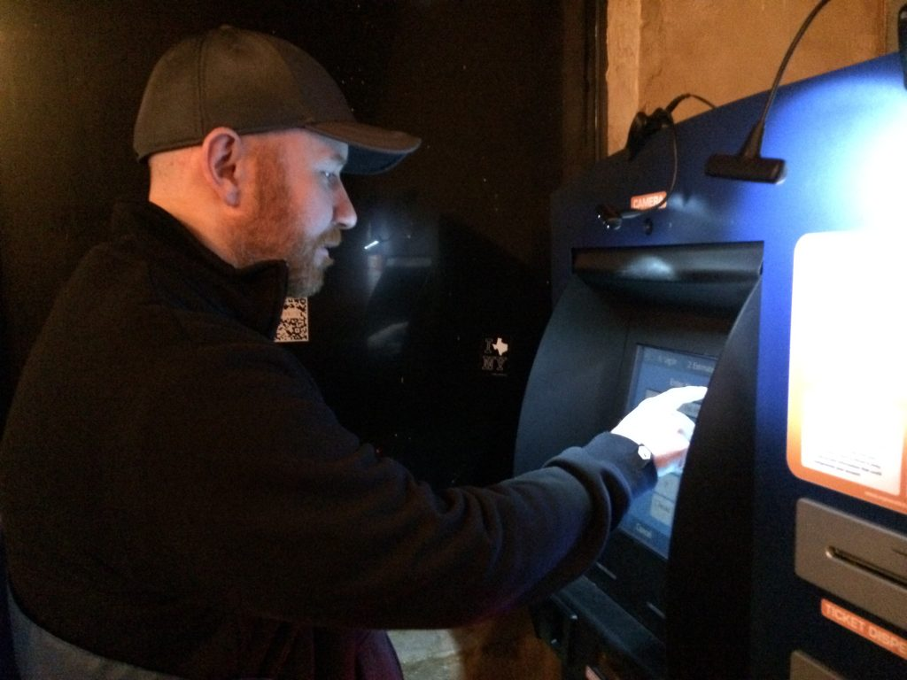 One bitcoin user tries the ATM machine at Handlebar in Austin