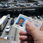 "Unlike a conventional California driver license, the one issued to undocumented motorists will have distinguishing marks, most prominently ""DP"" will be stamped on it, standing for driving privilege. Some undocumented drivers and immigration rights activists have expressed concerns that motorists could be singled out for possible deportation or police harassment if stopped and asked to show the new license.  Unrelated to the new law, some California cities, like Los Angeles, have special rules in place that prevent police asking about people's immigration status. (Photo: Saul Gonzalez)"