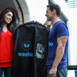 A marketing photo for the laundry delivery service Washio.