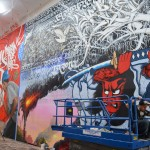 """Foreground: wall at ESMoA's """"Scratch"""" exhibit curated by Defer, featuring Cryptik, Patrick Martinez, Saber, Prime, Big Sleepz, and Gajin Fujita. Background: wall curated by Eyeone, featuring Gorgs, Tanner, Kozem, and Swank Courtesy Getty Research Institute"""