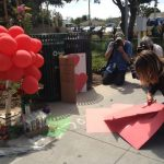 SMC community members set up a memorial for those killed. (Photo: Avishay Artsy)