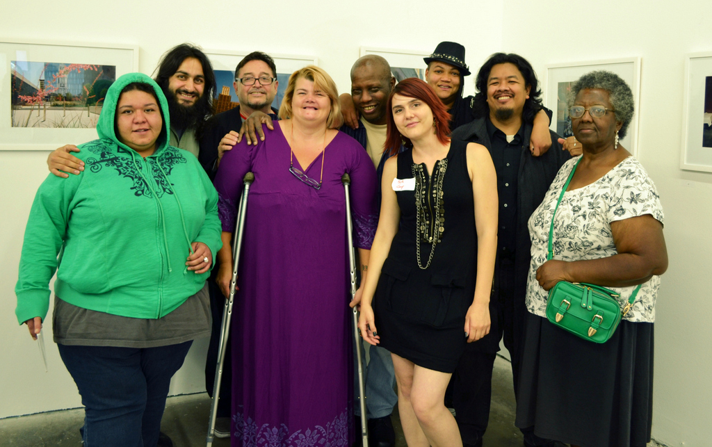 Artists living on (and formally residents of) Skid Row pose for a snap shot with LAMP Community employees who run the non-profit's arts program.