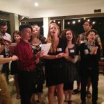 Students participating in the Helix Project perform a Yiddish song at a home in Studio City.