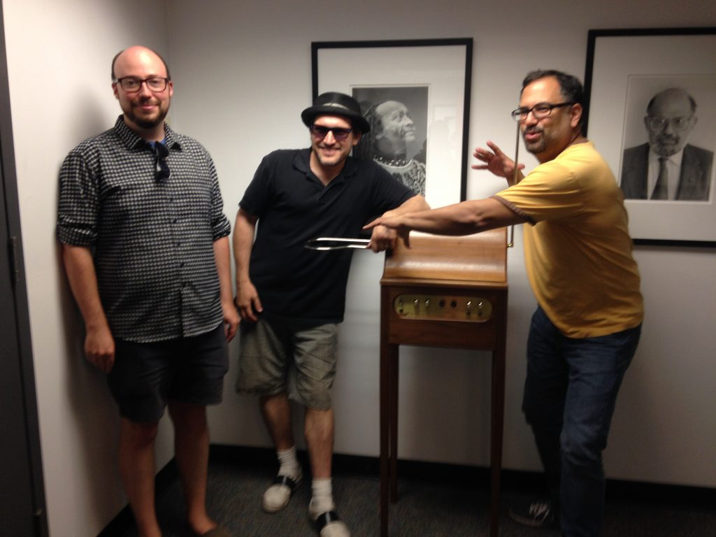 From left: Sean Michaels, Eban Schletter, and Steve Chiotakis practice their theremin skills at KCRW.