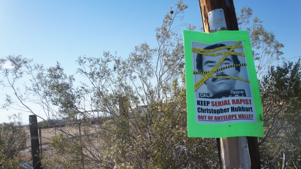 One of the signs that have been up in the Antelope Valley showing an archival photo of Christopher Hubbart and demanding that he leave. In the 1970s and 80s, Hubbart raped women across California. He was also the first person admitted to California's sexually violent predator program. (Photo: Saul Gonzalez)