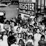 "African American children gather around a sign encouraging people to register to vote.   Date: 1960s  Collection: International Ladies Garment Workers Union Photographs (1885-1985)   Photo credit: ""a href=""http://www.flickr.com/photos/kheelcenter/5279449524/in/photolist-93wypN-4TnBmu-93tUwK-93wkss-4yLAoK-62ezFT-5FTcfa-5x44Mu-9xri1L-aVuyQ8-5U1ETz-fKcMAT-5ztzC3-93tsyF-mETrX5-5wYPgZ-5zor2b-5zj82T-5U3hbA-ac55u-5zopnh-8BMPDe-5zopsJ-5zj764-fTRP7-5zoqJq-fP4aKv-fPkHa5-5zoqf5-5zj94z-5zj9gB-5zoq3d-5zj6Za-5zj7jx-5zj9s6-5zj9Ki-hE5oza-5zoqQh-5wYUJp-5yZcMq-obhqWn-2qkXze-GPXx2-5x4mvj-5zj8cV-5zj8AZ-5x4eH3-5zj6V6-obgoJG-7VBLqS/""> The Kheel Center for Labor-Management Documentation and Archives in the ILR School at Cornell University"