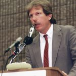 "Gary Webb addressing an audience after the publishing of his ""Dark Alliance"" series in the ""San Jose Mercury News."" Webb's reporting sparked a national conversation about the role of the CIA in cocaine smuggling and led tot he destruction of Webb's career."