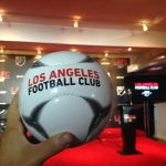 Soccer balls were distributed to reporters to celebrate LA's new soccer team.