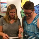 Dr. Jo Olson and Wes review paperwork at a support group group for parents and caregivers with gender non-conforming and transgender children, teens and young adults. Photo credit: Aydin Kennedy