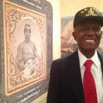 Colonel Franklin J. Henderson and a portrait of a Civil War serviceman