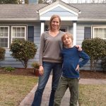 Michele and her son in front of their home, which they could never have afforded in Los Angeles.