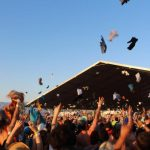 Concert goers toss t-shirts in the air at the 2014 Coachella Music & Arts Festival. The Rose Bowl is pursuing a music festival of its own, slated for the summer of 2016.