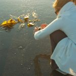 sara photographing trash