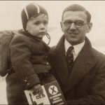 Nicholas Winton holds a child in a train station in Prague in 1939. Winton helped save more than 650 childen by getting them out of Czechoslovakia before the Nazis arrived. Courtesy Nicholas Winton